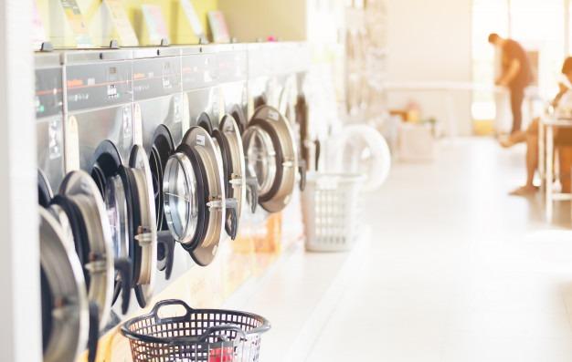 row-industrial-laundry-machines-laundromat-public-laundromat-with-laundry-basket-laundrymann pg